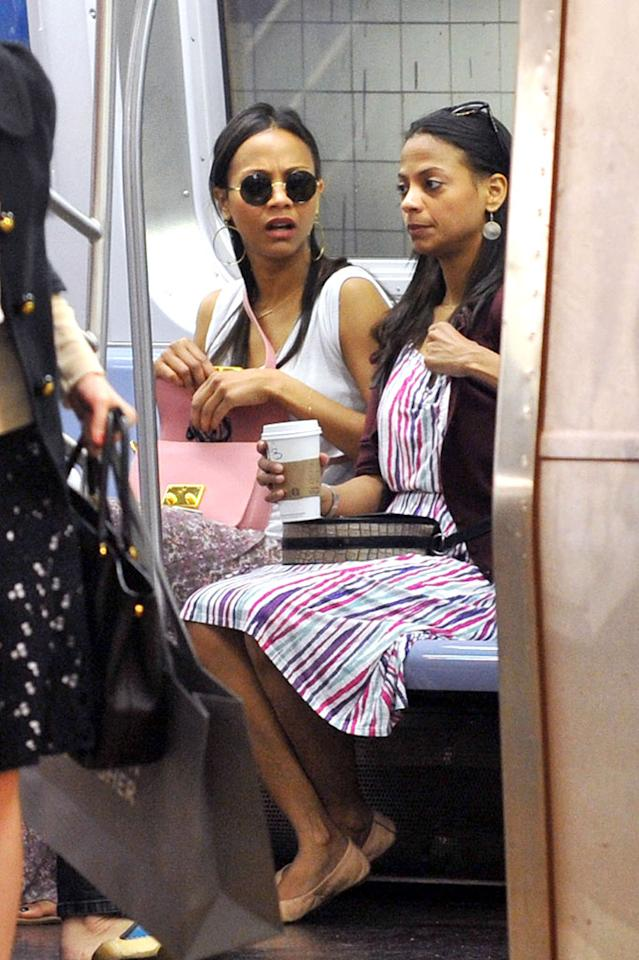 "Zoe Saldana, star of the upcoming untitled ""Star Trek"" sequel, and her sister Cisely are seen hopping on the subway together in New York City"