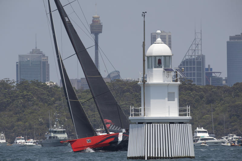 Comanche goes through some final checks before the start of the Sydney Hobart yacht race on Sydney Harbour, Thursday, Dec. 26, 2019. (AP Photo/Steve Chirsto)
