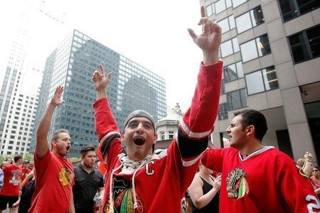 Jun 18, 2015; Chicago, IL, USA; Chicago Blackhawks fans cheer during the 2015 Stanley Cup championship parade and rally at Soldier Field. Mandatory Credit: Jon Durr-USA TODAY Sports