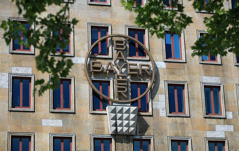 The logo of Bayer AG is pictured at the facade of the historic headquarters of the German pharmaceutical and chemical maker in Leverkusen, Germany, April 27, 2020. REUTERS/Wolfgang Rattay