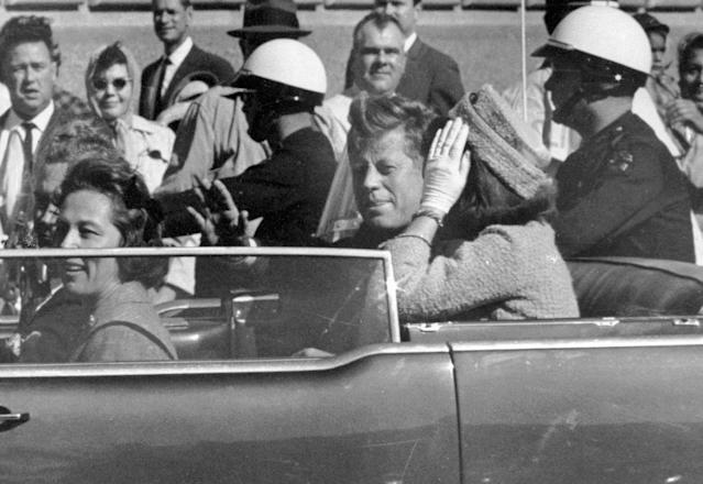 <p>President John F. Kennedy waves from his car in a motorcade approximately one minute before he was shot in Dallas on Nov. 22, 1963. Riding with Kennedy are First Lady Jacqueline Kennedy, right, Nellie Connally, second from left, and her husband, Texas Gov. John Connally, far left. The National Archives has until Oct. 26, 2017, to disclose the remaining files related to Kennedy's assassination, unless President Donald Trump intervenes. (Photo: Jim Altgens/AP) </p>