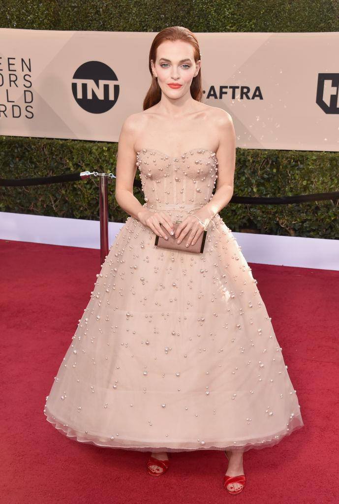 <p>Brewer's bright red lip paired perfectly with her pearl midi-dress. (Photo: Getty Images) </p>
