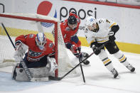 Washington Capitals goaltender Vitek Vanecek (41) stops the puck against Pittsburgh Penguins center Colton Sceviour (7) during the first period of an NHL hockey game, Tuesday, Feb. 23, 2021, in Washington. Also seen is Capitals defenseman Brenden Dillon (4). (AP Photo/Nick Wass)