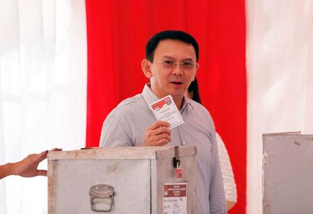 "Incumbent Governor Basuki ""Ahok"" Tjahaja Purnama casts his vote in the Jakarta governor election in North Jakarta"