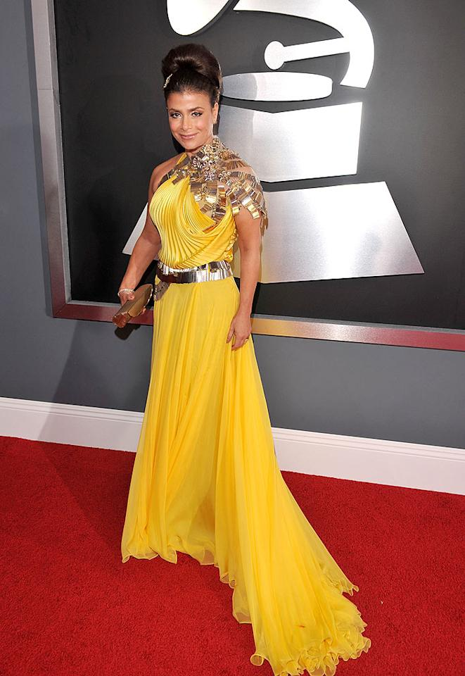 "Bad: Paula Abdul's canary-colored catastrophe featured an overly ruched bodice, a bizarre metallic shoulder piece, and an unnecessary belt. Lester Cohen/<a href=""http://www.wireimage.com"" target=""new"">WireImage.com</a> - February 8, 2009"