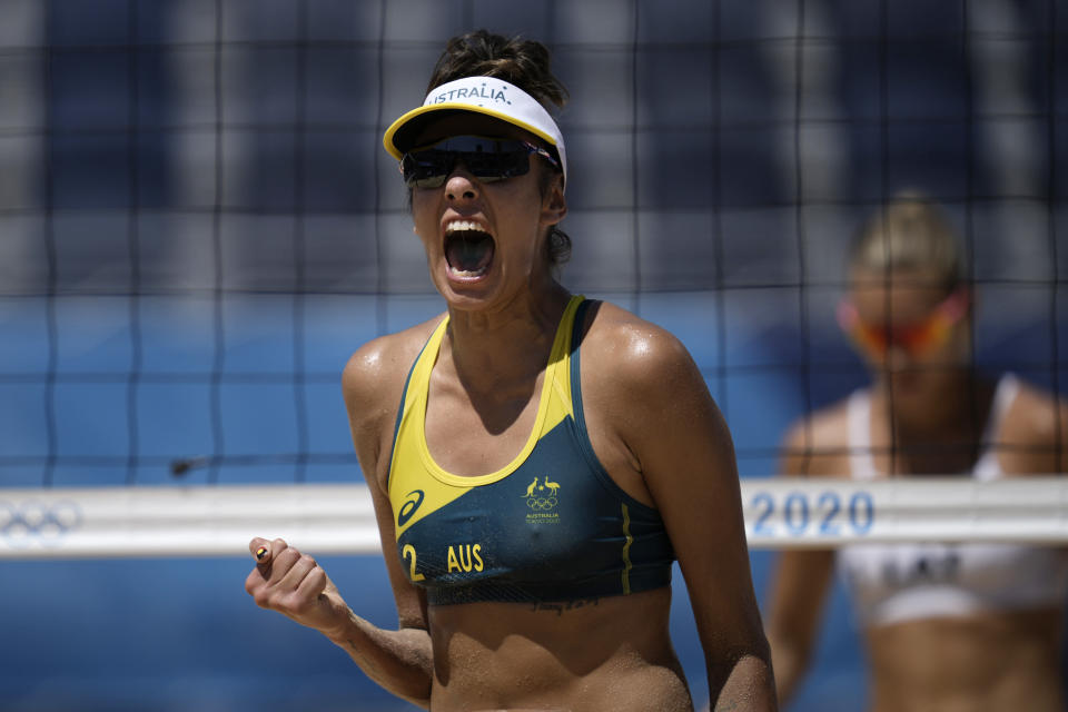 Taliqua Clancy, of Australia, celebrates winning the first set during a women's beach volleyball semifinal match against Latvia at the 2020 Summer Olympics, Thursday, Aug. 5, 2021, in Tokyo, Japan. (AP Photo/Felipe Dana)