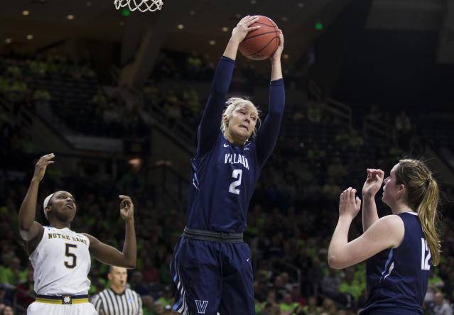 Villanova's Alex Louin (2) grabs a rebound over teammate Megan Quinn (12) and Notre Dame's Jackie Young (5) during a second-round game in the NCAA women's college basketball tournament Sunday, March 18, 2018, in South Bend, Ind. (AP Photo/Robert Franklin)