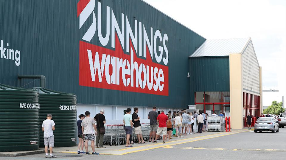 People can be seen social distancing while waiting to get into a Bunnings store. Source: AAP