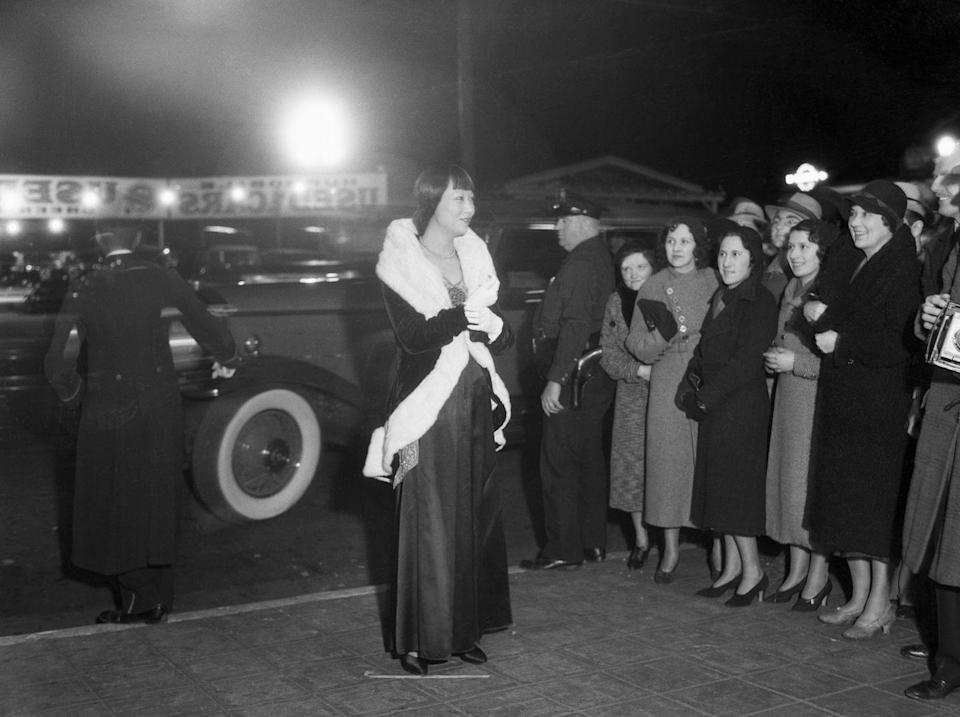 <p>Wong, surrounded by fans, emerged from her car at Hollywood's Music Box Theater for the premiere of <em>The Old Woman</em>. </p>