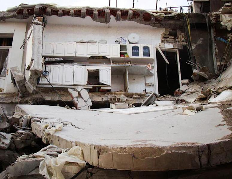 In this citizen journalism image provided by Lens Young Homsi, which has been authenticated based on its contents and other AP reporting, a destroyed house from Syrian government forces shelling, at Jouret al-Shiyah, in Homs province, Syria, Thursday Oct. 18, 2012. Syrian activists say a string of government airstrikes on rebel areas in the country's north has killed at least 20 people, leveled buildings and forced residents to dig through mounds of rubble in search of survivors. (AP Photo/Lens Yong Homsi)