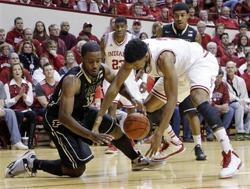 Purdue guard Rapheal Davis, left, and Indiana forward Christian Watford go for a loose ball in the second half of a NCAA college basketball game in Bloomington, Ind., Saturday, Feb. 16, 2013. Indiana defeated Purdue 83-55. (AP Photo/Michael Conroy)