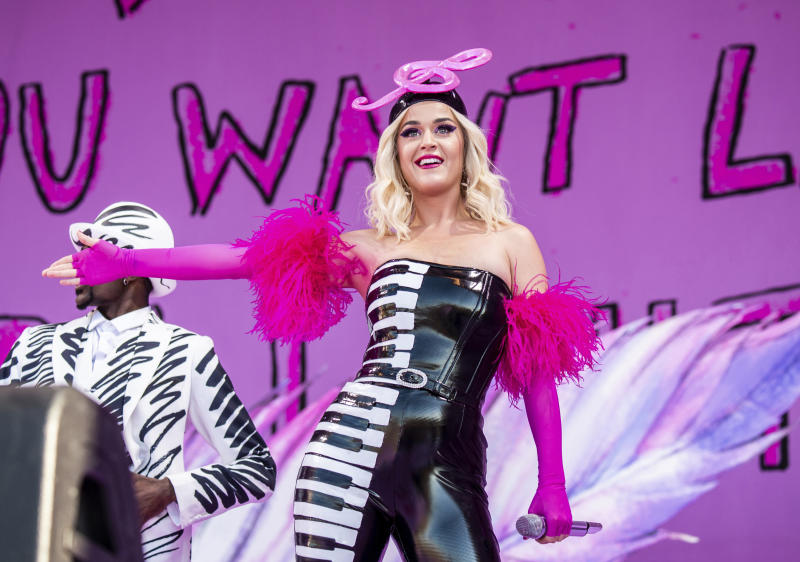 """FILE - This April 27, 2019 file photo shows Katy Perry at the New Orleans Jazz and Heritage Festival in New Orleans. The penalty phase in a copyright infringement trial will begin Tuesday, July 30, 2019, in Los Angeles and will determine how much Perry and other creators of her hit song """"Dark Horse"""" will owe for improperly copying elements of a 2009 Christian rap song. (Photo by Amy Harris/Invision/AP, File)"""