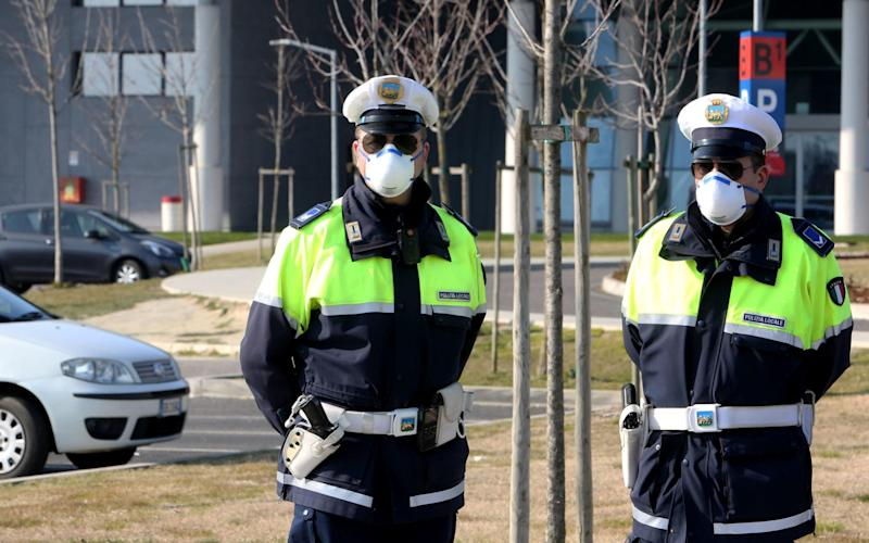 Police on guard at the hospital near Padova where tests for the coronavirus are performed on the population in Veneto region, northern Italy - NICOLA FOSSELLA/EPA-EFE/REX
