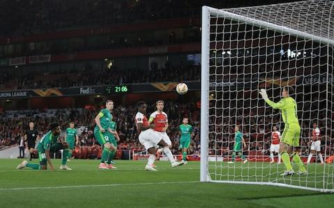 Welbeck heads in Arsenal's second - Credit: Marc Atkins/Getty Images