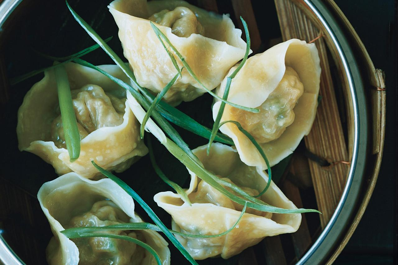 """Ground pork and chives are steamed in homemade wrappers to make these dumplings. It's believed that the more dumplings you eat in the year, the wealthier you're going to be. (As if you needed another reason to eat more dumplings.) <a href=""""https://www.epicurious.com/recipes/food/views/pork-and-chive-dumplings-350205?mbid=synd_yahoo_rss"""">See recipe.</a>"""