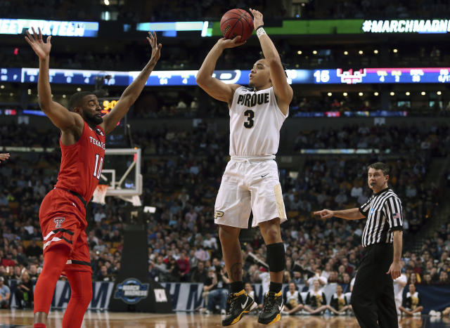 Purdue's Carsen Edwards, right, shoots against Texas Tech's Niem Stevenson during the first half of an NCAA men's college basketball tournament regional semifinal Friday, March 23, 2018, in Boston. (AP Photo/Mary Schwalm)