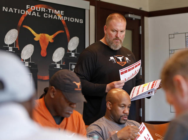 Texas Longhorns head strength and conditioning coach for football Yancy McKnight talks with other coaches during a meeting Wednesday Sept. 4, 2019 in Austin, Tx. ( Photo by Edward A. Ornelas )