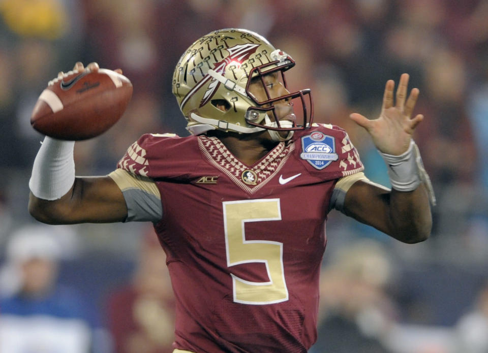 Florida State quarterback Jameis Winston (5) looks to pass against Georgia Tech during the first half of the Atlantic Coast Conference championship NCAA college football game in Charlotte, N.C., Saturday, Dec. 6, 2014. (AP Photo/Mike McCarn)