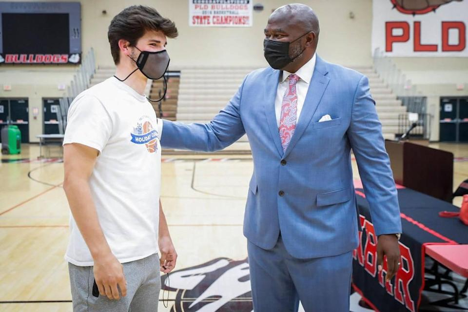 """Paul Laurence Dunbar basketball player Max Van Dyke greeted newly announced head coach Murray Garvin at Friday's announcement. """"We have a lot of seniors and we want to go out with a bang, so hopefully, we can do that,"""" Van Dyke said."""