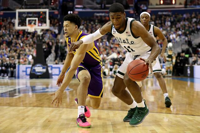 <p>Aaron Henry #11 of the Michigan State Spartans dribbles against Skylar Mays #4 of the LSU Tigers during the first half in the East Regional game of the 2019 NCAA Men's Basketball Tournament at Capital One Arena on March 29, 2019 in Washington, DC. (Photo by Patrick Smith/Getty Images) </p>