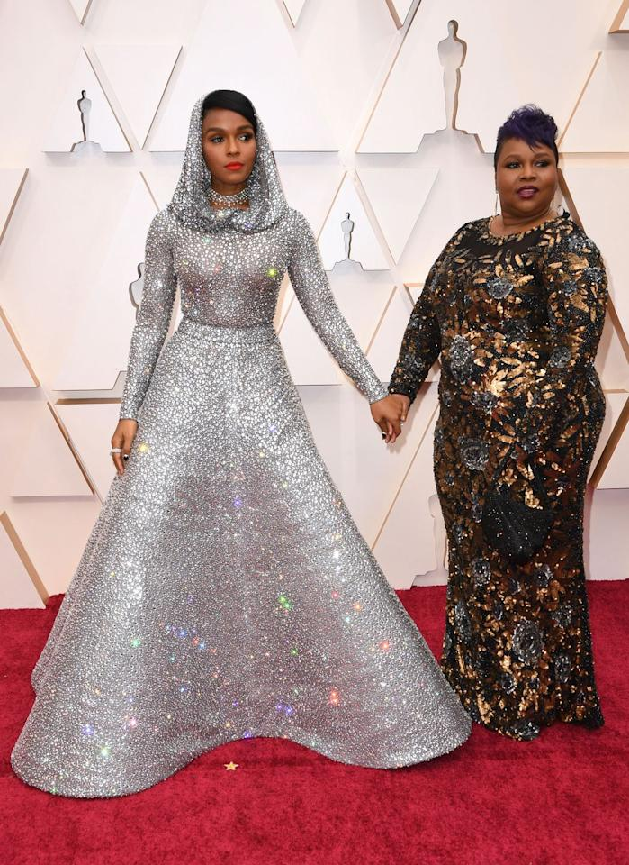 <p>Janelle Monae, who turned heads in a statement Ralph Lauren hooded dress, posed with her mother Janet. </p>