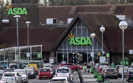 FILE PHOTO - Shoppers leave the Asda superstore in High Wycombe, Britain, February 7, 2017.  Picture taken February 7, 2017. REUTERS/Eddie Keogh