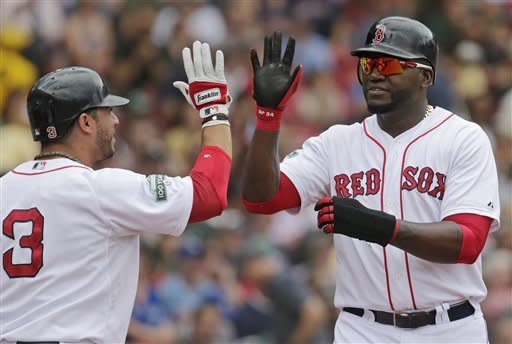 Boston Red Sox' David Ortiz, right, is congratulated by teammate Mike Aviles after scoring on a single by teammate Adrian Gonzalez during the fourth inning of a baseball game against the Toronto Blue Jays at Fenway Park in Boston, Wednesday, June 27, 2012. (AP Photo/Charles Krupa)
