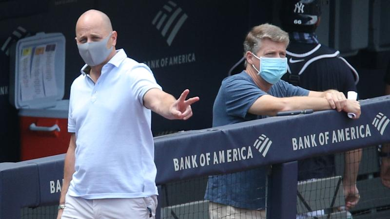 Yankees GM Brian Cashman and managing general partner/co-chairperson Hal Steinbrenner