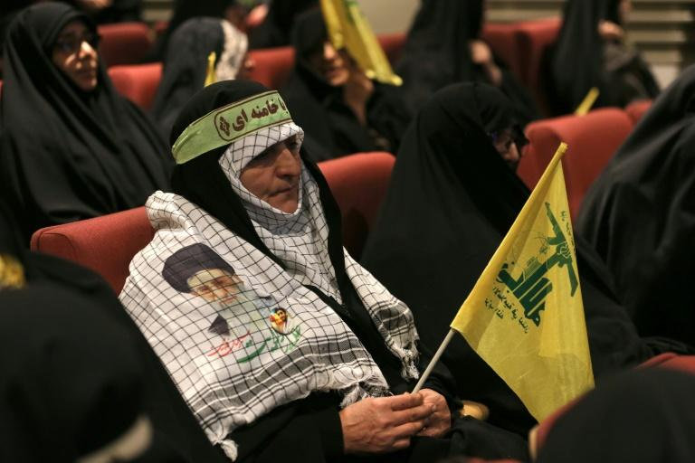 "Basij militia women attend a Tehran press conference where a Revolutionary Guards commander warned that Iran will severely punish ""mercenaries"" arrested over a recent wave of street violence"