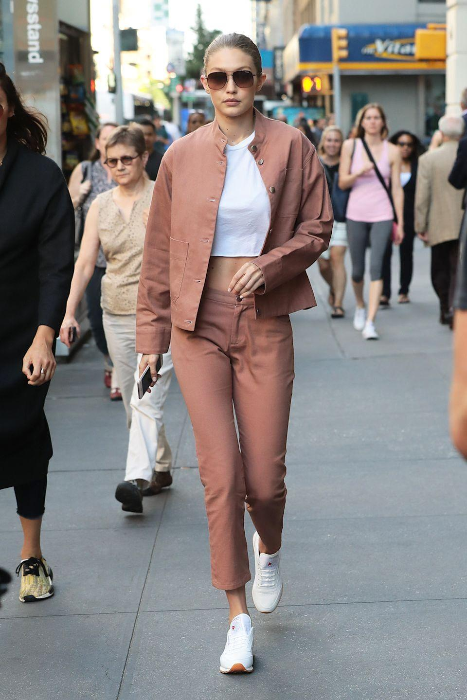 <p>In a deep blush army jacket, matching pants, a white crop top and trainers while out in NYC. </p>