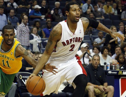 Memphis Grizzlies guard Mike Conley (11) goes for the ball as Toronto Raptors forward James Johnson (2) heads to the hoop in the first half of an NBA basketball game on Friday, March 16, 2012, in Memphis, Tenn. (AP Photo/Alan Spearman)