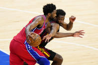 Atlanta Hawks' Solomon Hill, right, tries to get the ball away from Philadelphia 76ers' Joel Embiid during the second half of Game 1 of a second-round NBA basketball playoff series, Sunday, June 6, 2021, in Philadelphia. (AP Photo/Matt Slocum)
