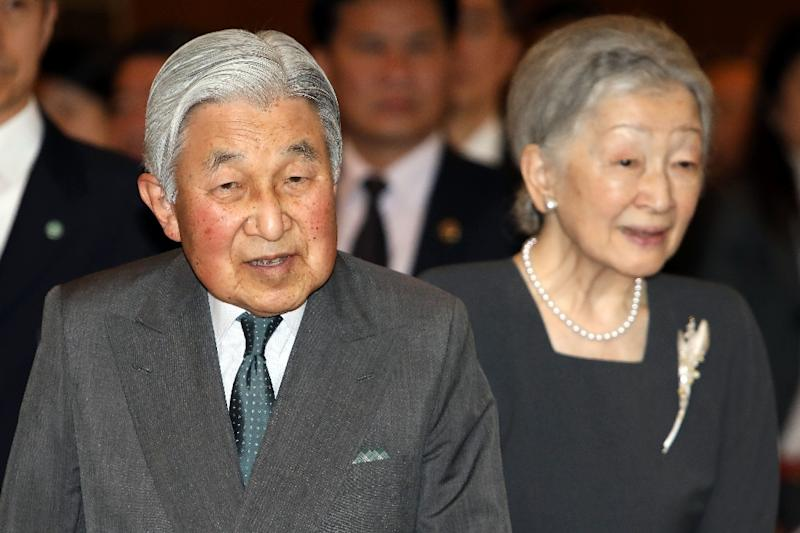 Japan's Emperor Akihito and Empress Michiko arrive for a meeting in Hanoi with family members of Japanese veterans living in Vietnam on March 2, 2017