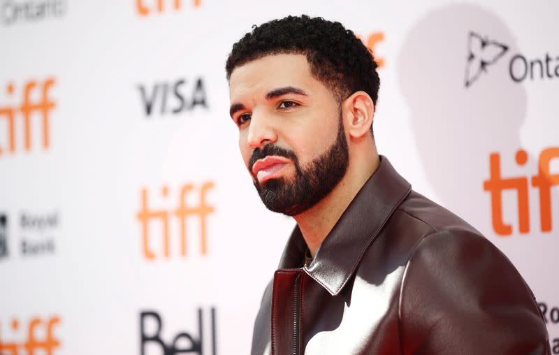 """Drake arrives on the red carpet for the film """"The Carter Effect"""" during the Toronto International Film Festival in Toronto"""