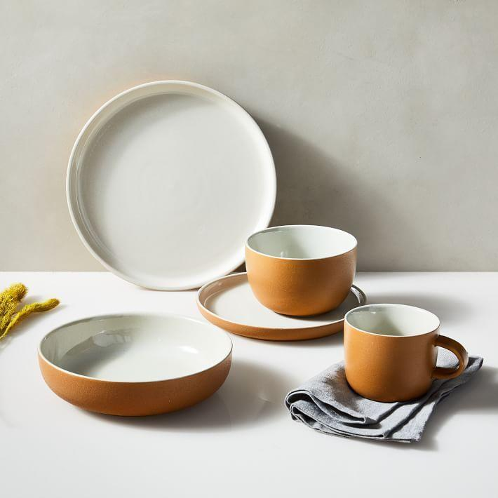 "<p>westelm.com</p><p><strong>$172.00</strong></p><p><a href=""https://go.redirectingat.com?id=74968X1596630&url=https%3A%2F%2Fwww.westelm.com%2Fproducts%2Fkaloh-dinnerware-set-amber-e2213&sref=https%3A%2F%2Fwww.housebeautiful.com%2Fentertaining%2Fholidays-celebrations%2Fg22778748%2Fthanksgiving-dinnerware%2F"" rel=""nofollow noopener"" target=""_blank"" data-ylk=""slk:BUY NOW"" class=""link rapid-noclick-resp"">BUY NOW</a></p><p>Looking for something that gives you subtle fall vibes but can still be used year-round? This white and amber stoneware dinnerware set is perfect.</p>"