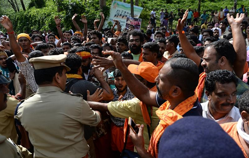Police tried to clear protesters who are against allowing women into the site (AFP Photo/ARUN SANKAR)
