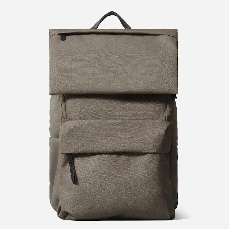 """This cool backpack is made with 100% recycled polyester and features a water-resistant finish — so when you inevitably spill your coffee on it, the cleanup will be a breeze. $78, Everlane. <a href=""""https://www.everlane.com/products/mens-renew-backpack-warm-charcoal"""" rel=""""nofollow noopener"""" target=""""_blank"""" data-ylk=""""slk:Get it now!"""" class=""""link rapid-noclick-resp"""">Get it now!</a>"""
