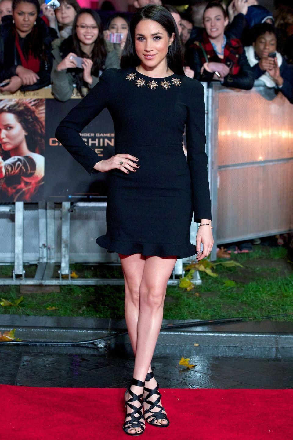 <p>Meghan wore this Alexander McQueen embellished wool dress for the World premier of the film 'The Hunger Games: Catching Fire' in Leicester Square, November 2013</p>