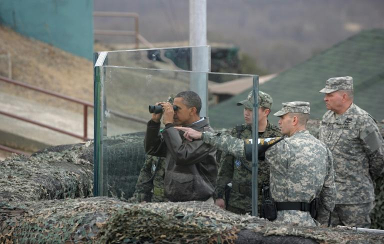 Former US president Barack Obama in 2012 looks towards North Korea from Observation Post Ouellette during a visit to the Joint Security Area of the Demilitarized Zone (DMZ)