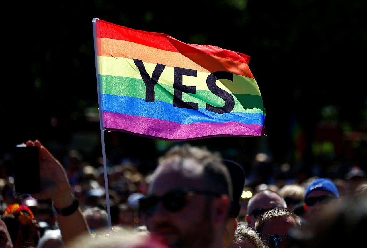 <p>Supporters of the 'Yes' vote for marriage equality celebrate after it was announced the majority of Australians support same-sex marriage in a national survey, paving the way for legislation to make the country the 26th nation to formalize the unions by the end of the year, at a rally in central Sydney, Australia, Nov. 15, 2017. (Photo: David Gray/Reuters) </p>