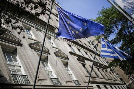 The flags of the European Union and Greece flutter at the Greece consulate in New York June 30, 2015. REUTERS/Eduardo Munoz - RTX1IHVG