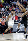 Arizona's Allonzo Trier (35) drives past Colorado's George King (24) during the first half of an NCAA college basketball game in the quarterfinals of the Pac-12 men's tournament Thursday, March 8, 2018, in Las Vegas. (AP Photo/Isaac Brekken)