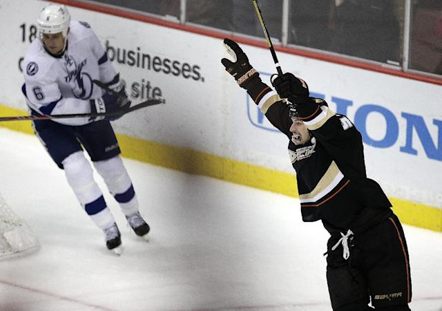 Anaheim Ducks' Ryan Getzlaf, right, celebrates his game-winning goal against the Tampa Bay Lightning in overtime of an NHL hockey game on Friday, Nov. 22, 2013, in Anaheim, Calif. The Ducks won 1-0 in overtime. (AP Photo/Jae C. Hong)