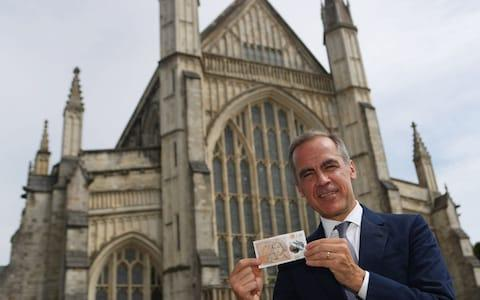 The Governor of the Bank of England, Mark Carney, during the unveiling at Winchester Cathedral, of the new £10 note featuring Jane Austen - Credit: Steve Parsons/PA Wire