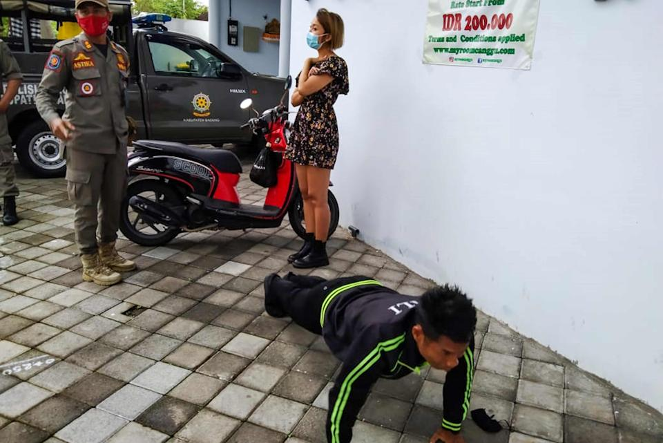 <p>In September, Bali started fining residents caught without a face mask 100,000 rupiah (£5.20).</p> (SATPOL PP/AFP via Getty Images)