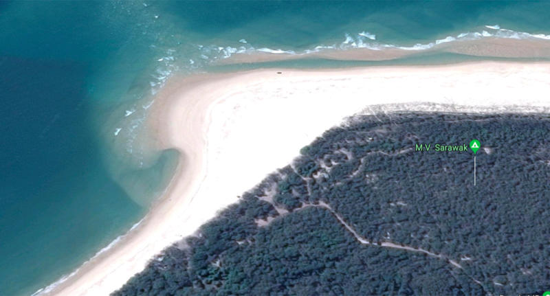 A sinkhole has opened up on a popular Queensland beach at Inskip Point, near Rainbow Beach.