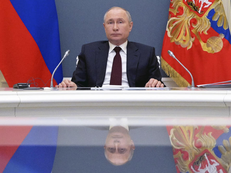 Russian President Vladimir Putin attends the virtual Leaders Summit on Climate in Moscow, Russia, Thursday, April 22, 2021. (Alexei Druzhinin, Sputnik, Kremlin Pool Photo via AP)