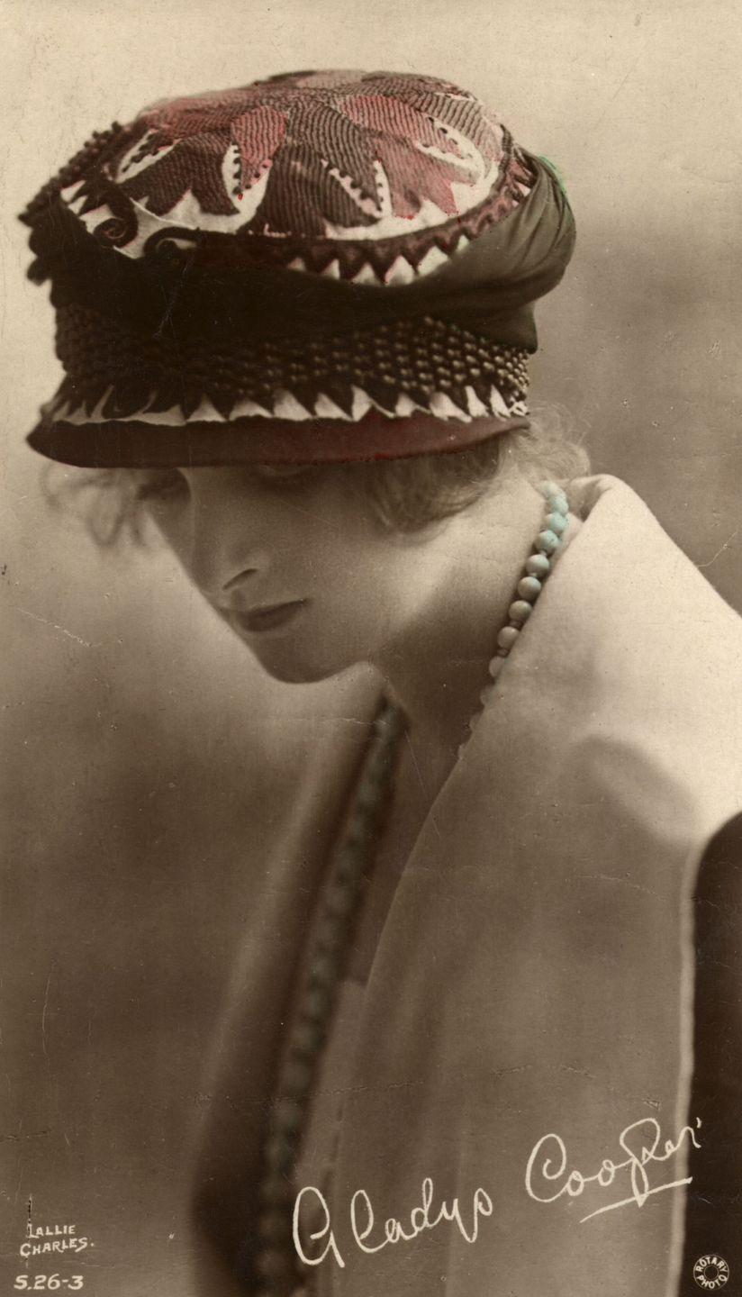 <p>This moody photo of Cooper was taken by Lallie Charles, an Irish photographer considered to be one of the most commercially successful female portraitists at the turn of the 20th century, along with her sister Rita. With her hair tucked into this beautifully embroidered newsboy cap, the actress still looks as fashion-forward as ever. </p>