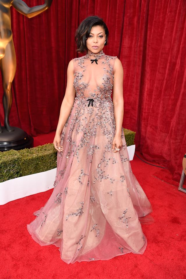 <p>Thanks to some carefully placed beading, Taraji P. Henson, nominated for <em>Hidden Figures</em>, just narrowly avoided showing off too much skin in her pale pink Reem Acra dress. (Photo: Getty Images) </p>