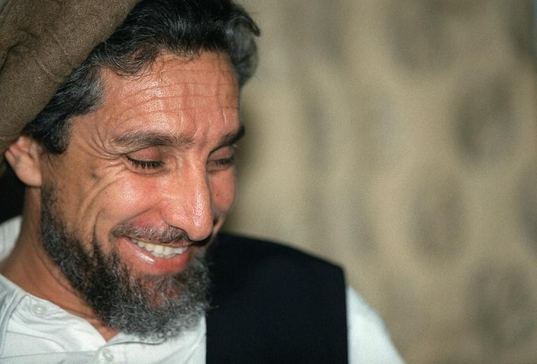 Ahmad Shah Massoud, known as the 'Lion of Panjshir', smiles during a 2001 interview with an AFP journalist in Afghanistan's Tahkar province (AFP Photo/JOEL ROBINE)